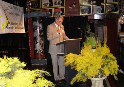 Terry Fewtrell at the podium at a Wattle a Day Dinner