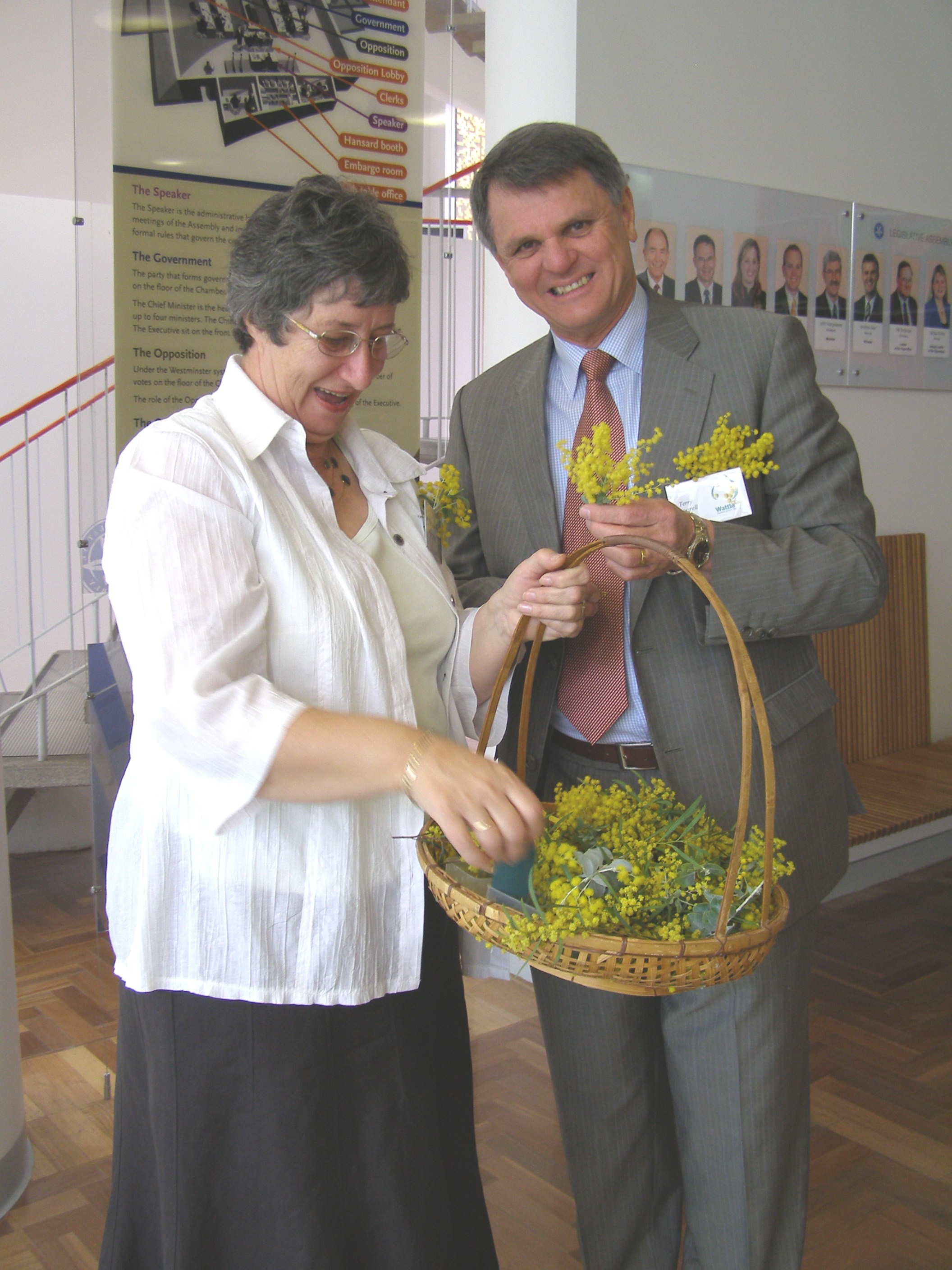 Citizenship ceremony - handing out wattle sprigs