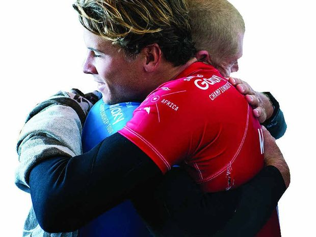 Julian Wilson (in red) hugs Mick Fanning