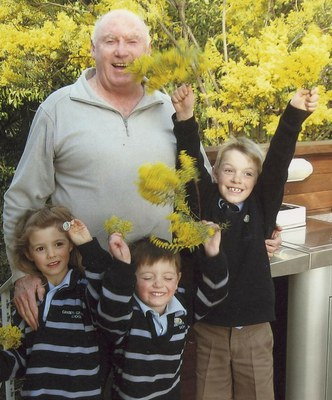 Jack Fahy and his grandchildren celebrate National Wattle Day